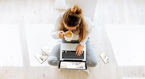 top view of woman working on responsive website scandinavian