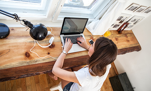 Brunette woman at desk with laptop