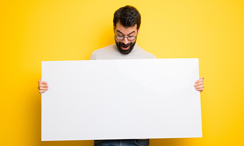 Man holding advertising board
