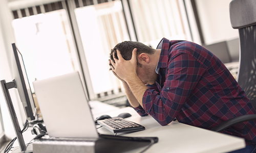Man stressed at computer_