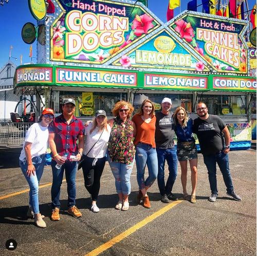ROI Online employees attending a fair