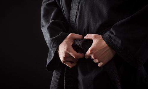 a man in a black karate suite