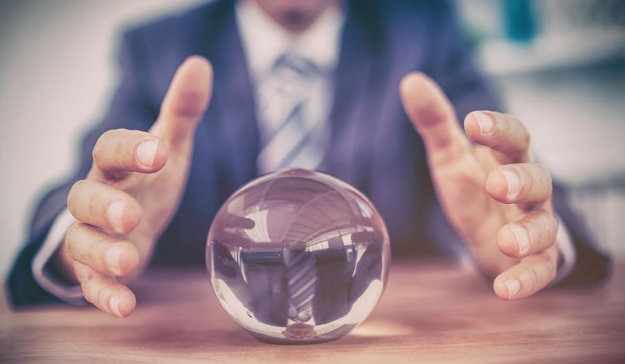 business-man-crystal-ball-marketing-predictions-2020